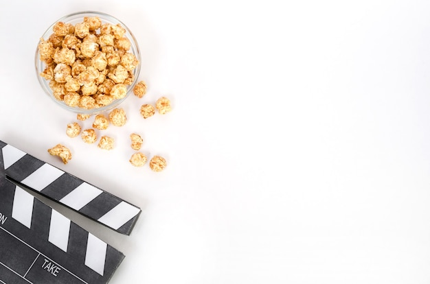 Movie clapperboard with popcorn