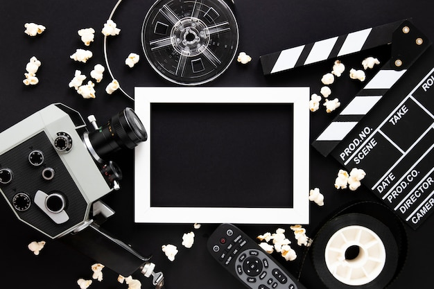 Movie elements on black background with empty frame