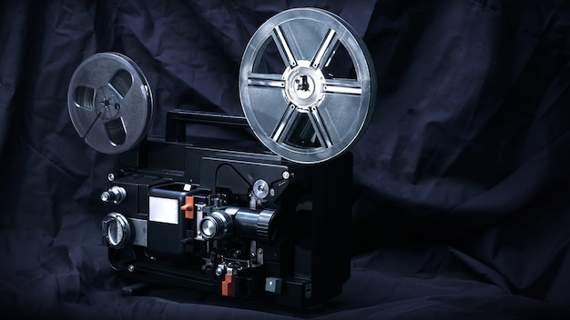 Movie projector on a dark background with light beam 8mm