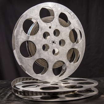 Movie reel on a black surface