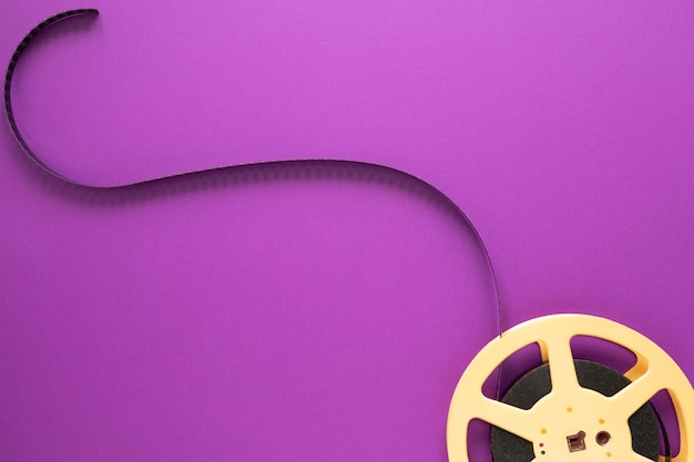 Movie reel on purple background