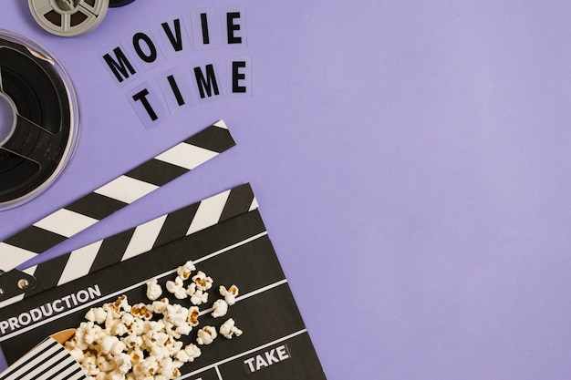 Movie slate and roll with popcorn