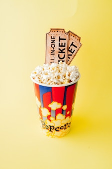 Movie tickets, film strips and popcorn
