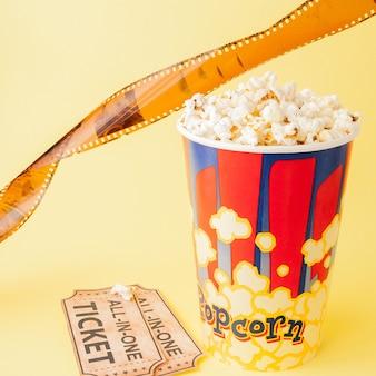 Movie tickets, film strips and popcorn