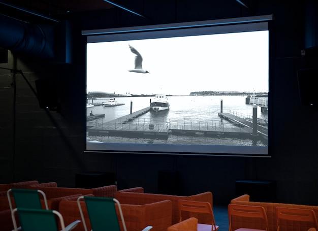 Movie time screening projector screen indoors room watch