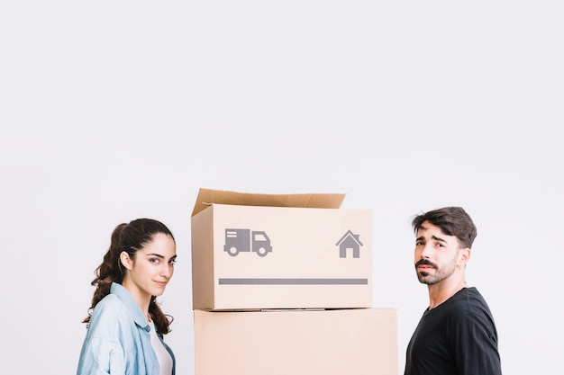 Moving concept with couple next to boxes