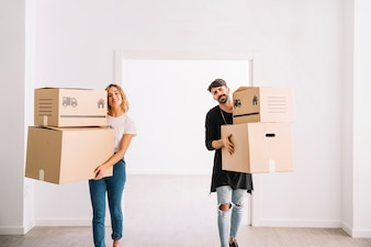 Moving concept with couple carrying packages