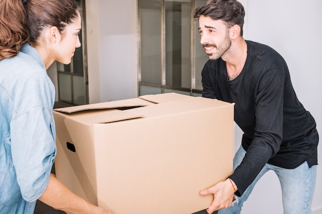 Moving concept with couple holding box