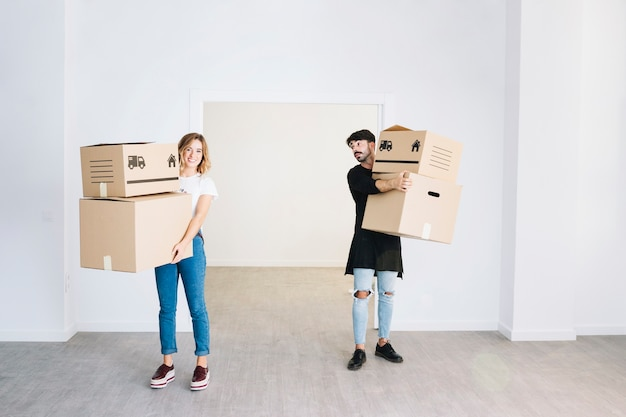 Moving concept with couple holding boxes