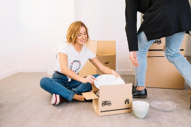 Moving scene with couple and boxes