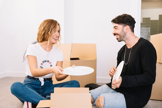 Moving scene with couple holding plate