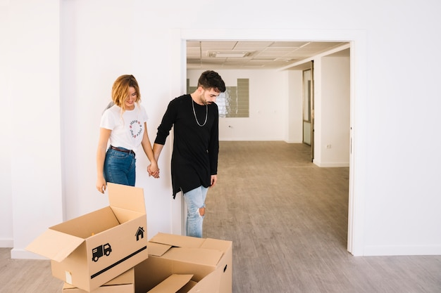 Moving scene with couple in room Free Photo
