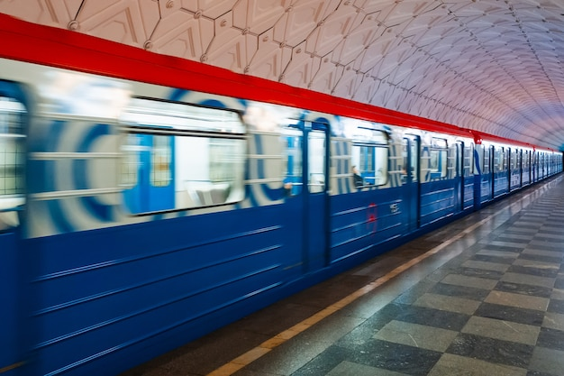 Moving train on the platform in the metro of moscow