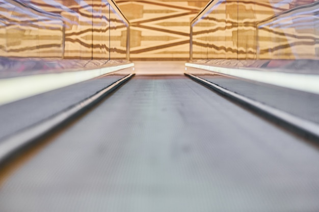 Moving walkway in shopping center. horizontal slow-moving conveyor mechanism for easy elevation