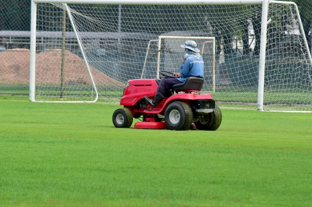 Mower and with a driver to take care of mowing in the football stadium always looks