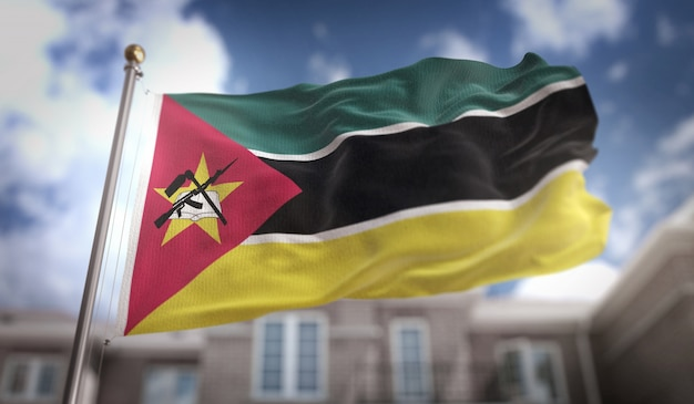 Mozambique flag 3d rendering on blue sky building background