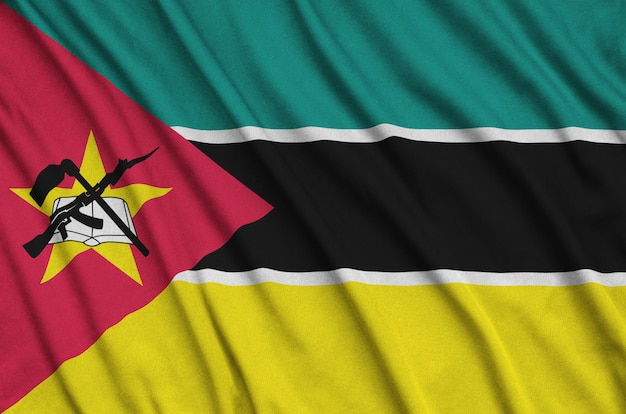 Mozambique flag is depicted on a sports cloth fabric with many folds.