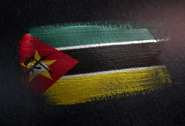 Mozambique flag made of metallic brush paint on grunge dark wall