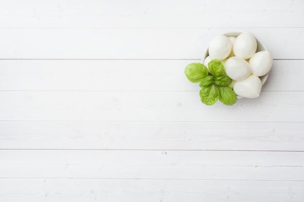 Mozzarella balls and basil in the dish,