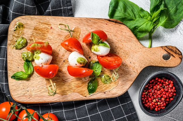 Mozzarella cheese canape sandwiches on skewers caprese salad