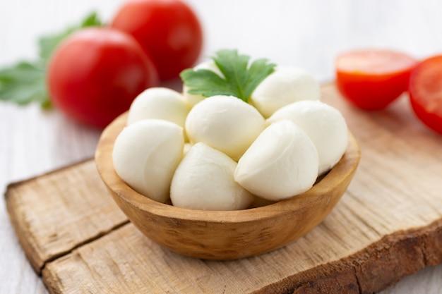 Mozzarella cheese in wooden bowl