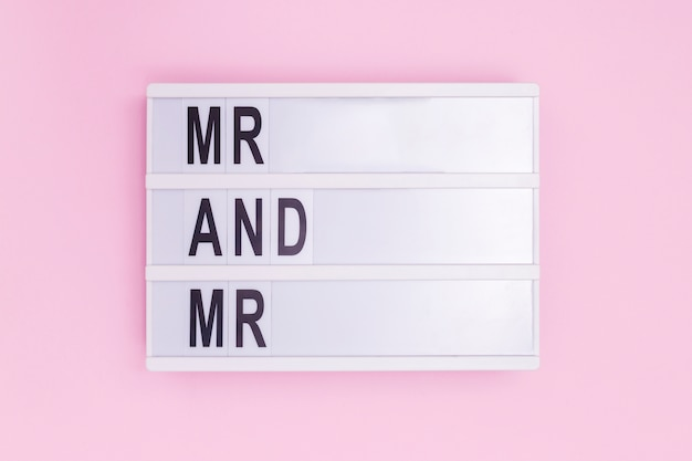 Mr and mr light box message on pink background