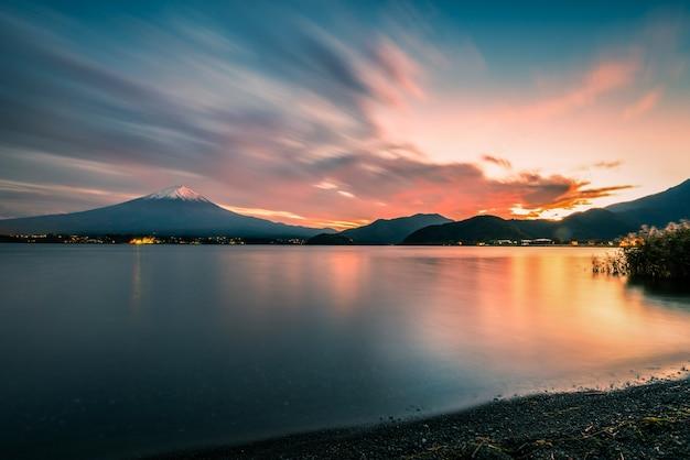 Mt. fuji over lake kawaguchiko at sunset in fujikawaguchiko, japan.