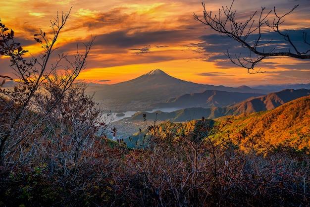 Mt. fuji over lake kawaguchiko with autumn foliage at sunrise in fujikawaguchiko, japan.