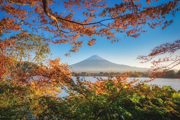 Mt. fuji over lake kawaguchiko with autumn foliage at sunset in fujikawaguchiko, japan.