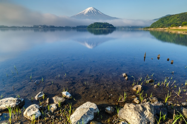 Mt. fuji reflected on water at kawaguchiko lake, yamanashi