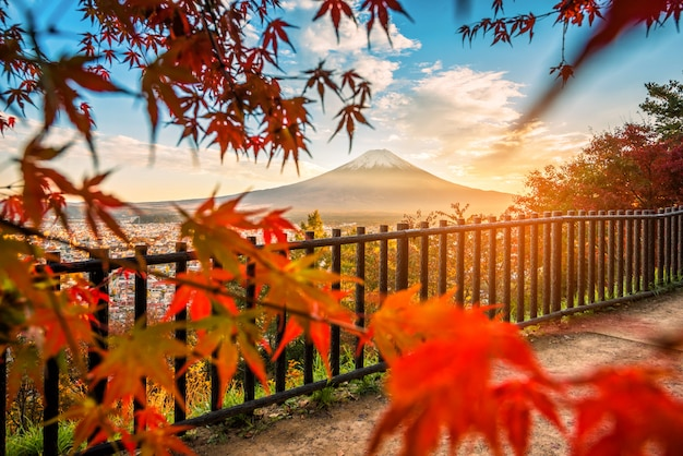 Mt. fuji with red leaf in the autumn on sunset at fujiyoshida, japan.