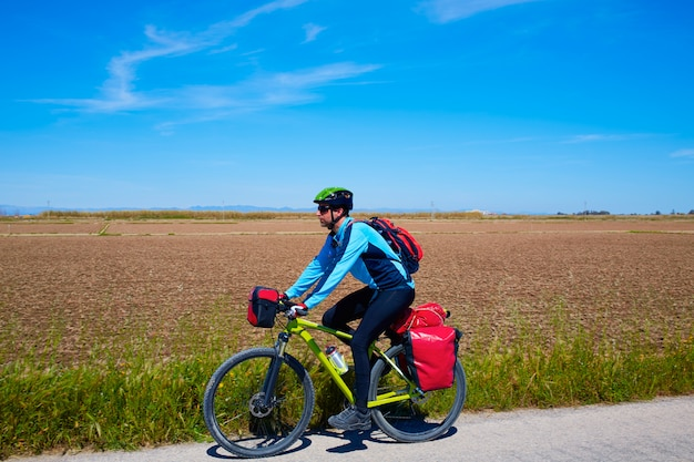 Mtb biker bicycle touring with pannier racks