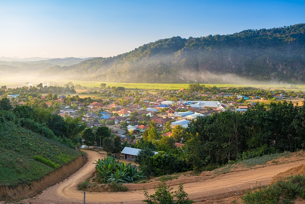 Muang long village in the golden triangle, luang namtha north laos near china burma thailand, small town in river valley with scenic mist and fog