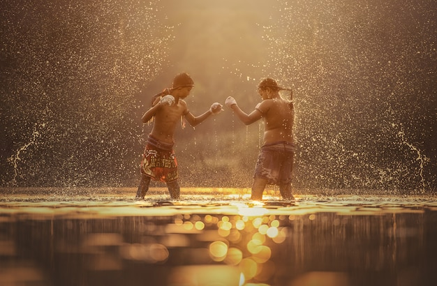 Muay thai, boxing fighters training outdoor