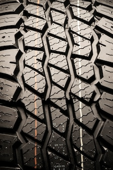 Mud tire protector for off-road vehicles. textural auto space, vertical photo