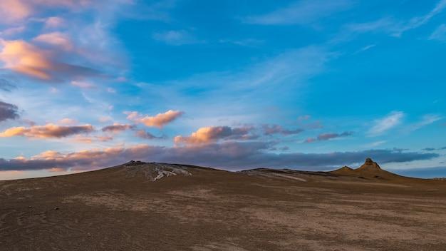 Mud volcanoes at sunset,  amazing natural phenomenon