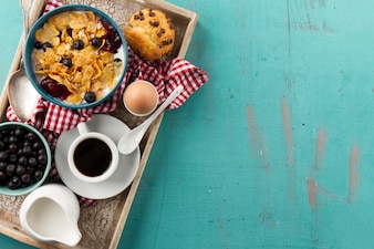 Muesli and coffee cup on tray