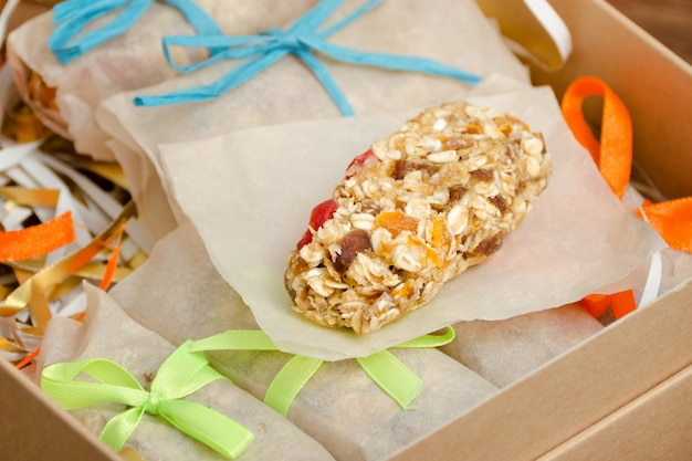 Muesli bar and package sweets.