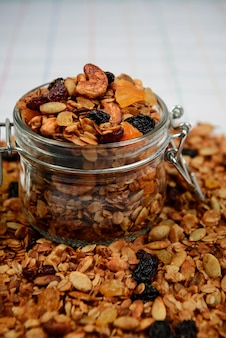 Muesli granola in transparent jar. close up.