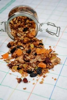 Muesli granola in transparent jar. close up.