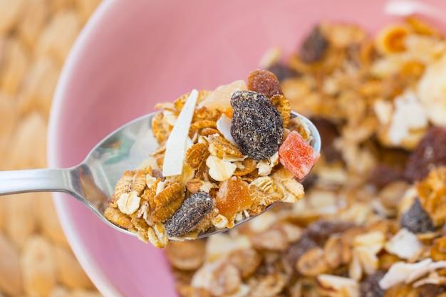 Muesli in the spoon, healthy food concept.