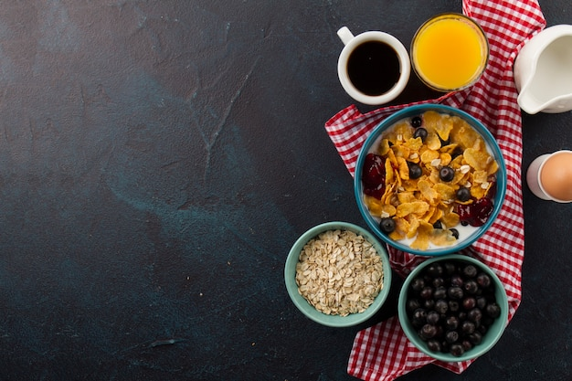 Muesli with berries and coffee cup