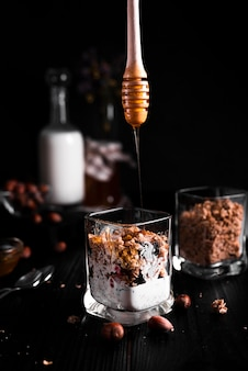 Muesli with honey and black background