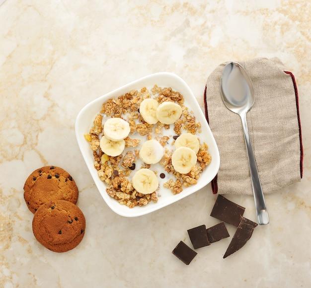Muesli with milk, banana and chocolate