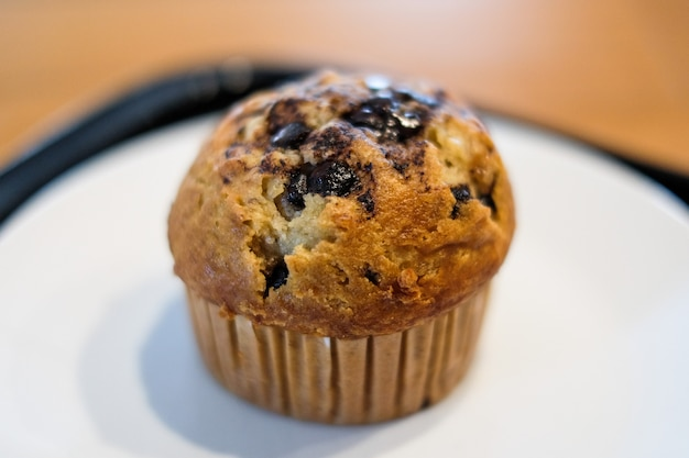 Muffin chocolate lava with chocolate chip and banana smell in paper cup for dessert.