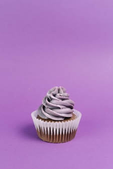 Muffin on violet background