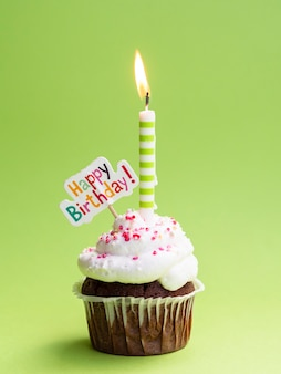 Muffin with candle and happy birthday sign