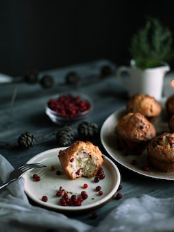 Muffin with lingonberries on a plate on the table