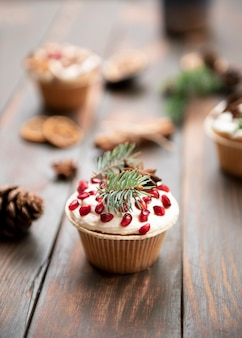 Muffin with pomegranate and pine