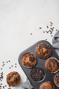 Muffins on baking tray with copy space